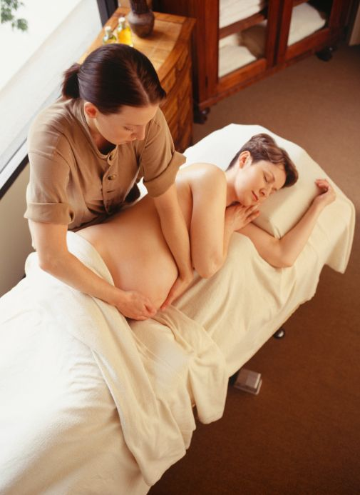 Pregnant woman having massage, elevated view